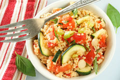 Couscous Salad. Couscous vegetable salad with basil; red striped napkin on side Stock Photography