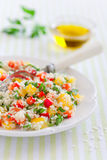 Couscous salad. With sweet peppers and herbs, selective focus Stock Photos