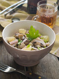 Couscous salad. With bacon and edible mushrooms, selective focus Stock Photos