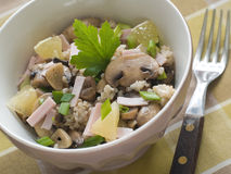 Couscous salad. With bacon and edible mushrooms, selective focus Royalty Free Stock Photography