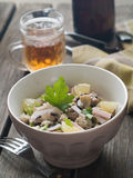 Couscous salad. With bacon and edible mushrooms, selective focus Royalty Free Stock Photo
