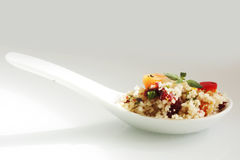 Couscous salad in spoon, close-up Stock Photos