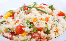 Couscous salad-Close Up. Couscous salad  peppers,tomatoes spring onion for the garnish Royalty Free Stock Photo