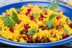 Couscous salad with curry, dried cranberries and herbs, close-up Royalty Free Stock Photography