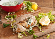 Couscous salad and fish steak Stock Image