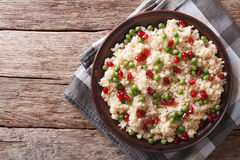 Couscous salad with green peas and pomegranate. horizontal top v Stock Image