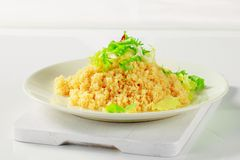 Couscous with salad greens Stock Image