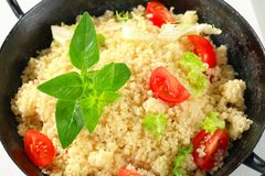Couscous with salad greens and tomato Stock Images
