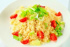 Couscous with salad greens and tomatoes Royalty Free Stock Photo