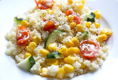 Couscous served with corns, zucchini and tomatoes Royalty Free Stock Photography