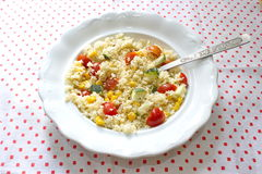 Couscous served with corns, zucchini and tomatoes Royalty Free Stock Photos