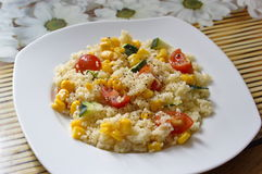 Couscous served with corns, zucchini and tomatoes Royalty Free Stock Photo