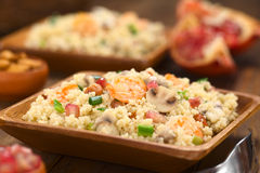 Couscous with Shrimp, Mushroom, Almond and Pomegranate Stock Image