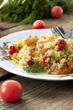 Couscous with shrimp, tomatoes and peppers. Couscous with shrimp, tomatoes and bell peppers Royalty Free Stock Images