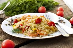 Couscous with shrimp, tomatoes and peppers. Couscous with shrimp, tomatoes and bell peppers Royalty Free Stock Photography
