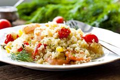 Couscous with shrimp, tomatoes and peppers Stock Images
