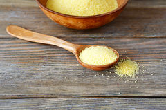 Couscous in a spoon on wooden boards Stock Images