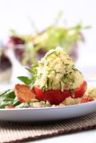 Couscous stuffed tomato Stock Photo