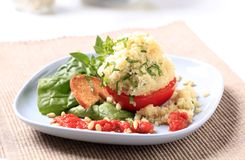Couscous stuffed tomato Stock Photography