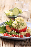 Couscous stuffed tomato Stock Images