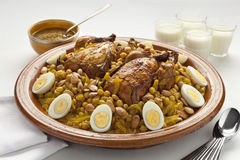 Moroccan couscous with chicken and caramelized Onions. Couscous Tfaya, Moroccan Couscous with chicken and caramelized Onions, almonds and hard boiled eggs Royalty Free Stock Images