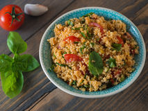 Couscous with tomatoes and basil Royalty Free Stock Photography