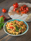 Couscous with tomatoes and basil Stock Photography