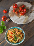 Couscous with tomatoes and basil Stock Image