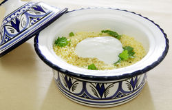 Couscous topped with yoghurt Stock Image