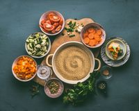 Couscous and various healthy organic diced vegetables ingredients in bowls with glass jar for lunch making. Top view. Vegetarian eating and cooking concept stock photo
