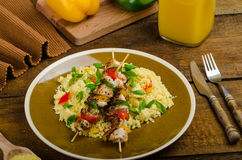 Couscous with vegetables and chicken skewer Royalty Free Stock Photo