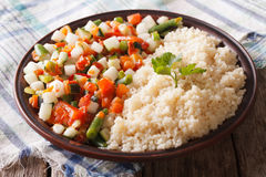 Couscous with vegetables and herbs closeup. horizontal Stock Photos