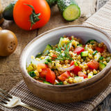 Couscous with vegetables. Israeli Ptitim. Stock Images