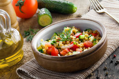 Couscous with vegetables. Israeli Ptitim. Stock Photo