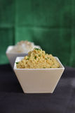 Couscous in white bowl Stock Photos