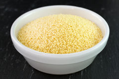 Couscous on white bowl Stock Photo