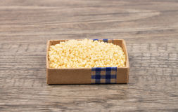 Couscous on wood Royalty Free Stock Image