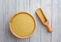 Couscous in wooden bowl Stock Image