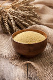 Couscous in a wooden bowl Royalty Free Stock Photos