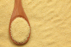 Couscous in a wooden spoon Royalty Free Stock Images