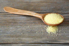 Couscous in a wooden spoon on boards Royalty Free Stock Photography