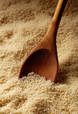Couscous and wooden spoon Royalty Free Stock Photo