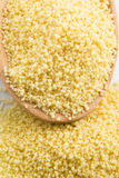 Couscous in wooden spoon royalty free stock photos