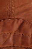 Cousez dans la veste en cuir brune II Image libre de droits