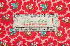 Cousez un peu de bonheur Photographie stock libre de droits