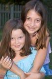 Cousins Embrace Stock Photo