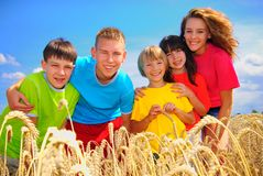 Cousins in grain field. Cousins together outside on summer day Stock Image