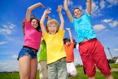 Cousins jump up. Cousins together outside on summer day Royalty Free Stock Photo