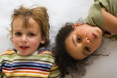 Cousins Too. A beautiful mixed race girl and her blond cousin having fun Royalty Free Stock Photos