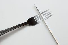 Couteau au-dessus de fourchette Photo stock
